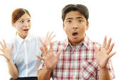 Surprised woman and man — Stock Photo