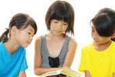 Girls reading a book — Stock Photo