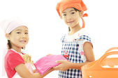 Children with laundry basket — Stock Photo