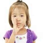 Cute little girl whispering — Stock Photo
