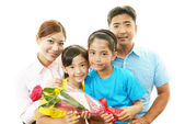 Happy family smiling together — Stock Photo