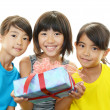 Smiling girls with gift — Stock Photo #29500001