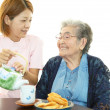 Stock Photo: Senior womwith her caregiver