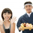 Sushi chef and customer — Stock Photo