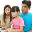 Happy family enjoy laptop — Stock Photo