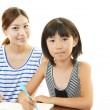 Child studying with mother — Stock Photo