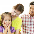 Happy family smiling together — Stock Photo #30353575