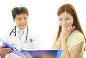 Happy medical doctor and patient — Stock Photo