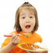 Little girl eating food — Stock Photo