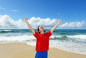 Young man on the beach enjoy sunlight — Stock Photo