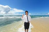 Young man on the beach enjoy sunlight — Stock Photo