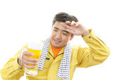 Worker drinking beer — Stock Photo