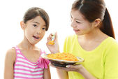 Child with mother eating food — Stock Photo