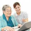 Senior lady enjoys computer — Stock Photo
