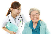 Smiling Asian medical doctor and senior woman — Stock Photo
