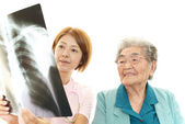 Asian medical doctor and senior woman — Stock Photo