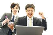 Smiling Asian businessman — Stock Photo