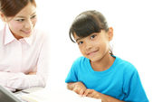 Young student studying with teacher — Stock Photo