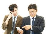 Stressed Asian businessmen — Stock Photo
