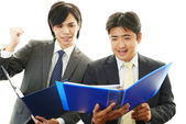 Smiling Asian businessmen — Stock Photo