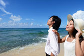Man and woman on the beach — Stock Photo