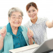 Stock Photo: Old womenjoys computer