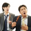 Men eating Yakitori — Stock Photo