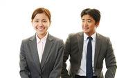 Imprenditrici e uomo d'affari sorridenti — Foto Stock