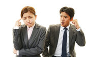 Dissatisfied businessman and businesswomen — Stock Photo