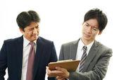 Stressed Asian businessmen — 图库照片