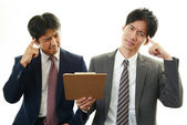 Aziatische zakenmensen benadrukt — Stockfoto