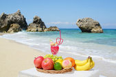 Tropical fruits and Beautiful beach — Stock Photo