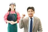 Smiling waitress with customer — Stock Photo