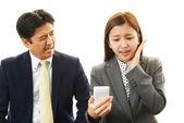 Dissatisfied businessman and businesswomen — Stock Photo