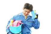 Tired Janitorial cleaning service man — Stock Photo