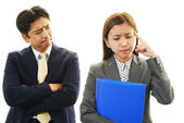 Stressed businessman and businesswoman — Stock Photo