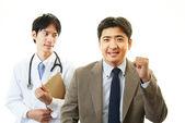 Sorrindo, paciente e médico asiático — Foto Stock
