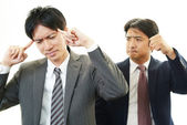Stressed Asian businessmen — Stock Photo