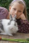 Girl and rabbit — Stock Photo