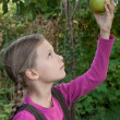 Girl and pear — Stock Photo