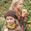 Girls and apples — Stock Photo