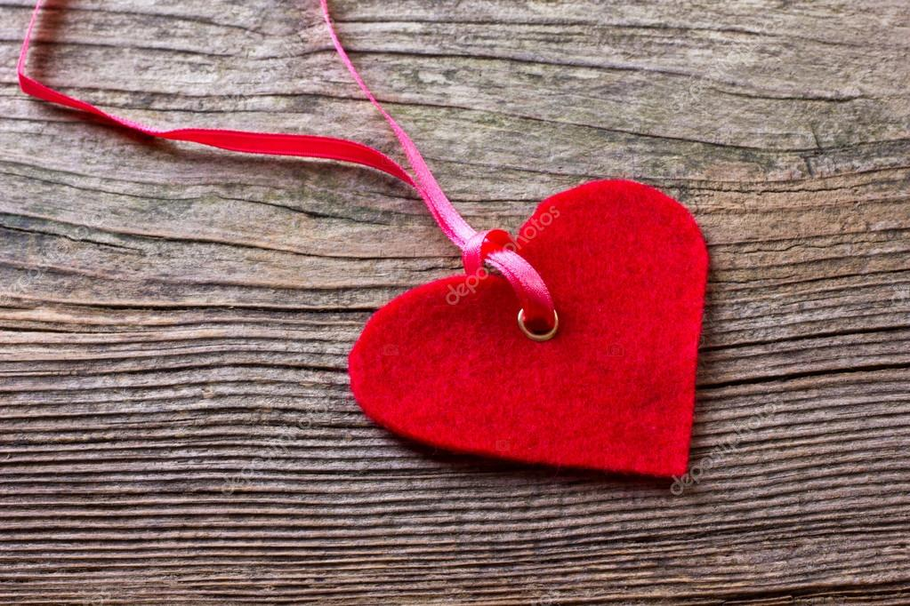 Red heart on wooden ground — Stock Photo #19569983