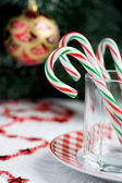 Christmas Candy Canes in a glass — Stock Photo