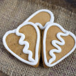 Three Heart shape gingerbread Cookie on sacking — Stock Photo #18365477