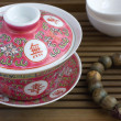 A traditional chinese gaiwan with tea on a tea table — Stock Photo
