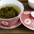 A chinese gaiwan with tea on a tea table — Stock Photo
