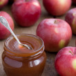 Apple confiture in Glass Jar with apples - Stock Photo