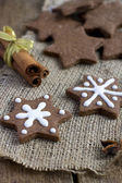 Star shape Christmas chocolate gingerbread Cookie on sacking — Stock Photo