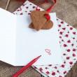 Love letter with heart shape cookies, hearts and red felt pen — Stock Photo