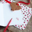 Love letter with heart shape cookies, hearts and red felt pen — Stock Photo #18420377